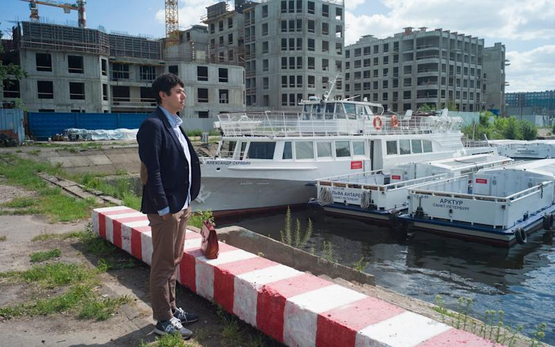 St. Petersburg tourism businessmen Nikolai Predtechensky in front of his pleasure boats, which are docked in a yacht-club as the civil navigation is suspended - Maria Turchenkova