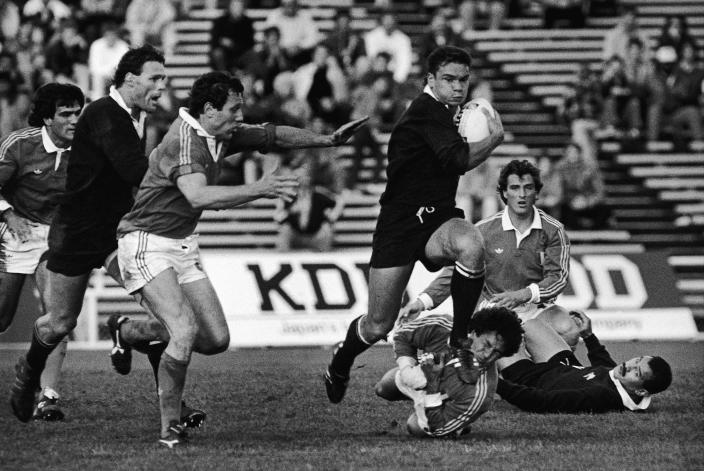 FILE - In this May 22, 1987, file photo Italy's Massimo Mascioletti takes New Zealand's Michael Jones's boot in the mouth in the inaugural Rugby World Cup Pool 3 match between New Zealand and Italy at Eden Park in Auckland, New Zealand. New Zealand Rugby has granted conditional approval, Wednesday, April 14, 2021, for two Pacific Islands teams to join an Australia-New Zealand Super Rugby tournament beginning next year. (AP Photo, File)