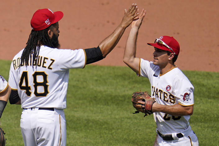 Pittsburgh Pirates relief pitcher Richard Rodriguez (48) celebrates with Adam Frazier after getting the final out of a baseball game against the Milwaukee Brewers in Pittsburgh, Sunday, July 4, 2021. (AP Photo/Gene J. Puskar)