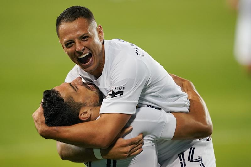 SAN JOSE, CA - OCTOBER 03: Sebastian Lletget #17 of the Los Angeles Galaxy celebrates scoring with Javier Hernandez #14 during a game between Los Angeles Galaxy and San Jose Earthquakes at Earthquakes Stadium on October 03, 2020 in San Jose, California.(Photo by John Todd/ISI Photos/Getty Images).