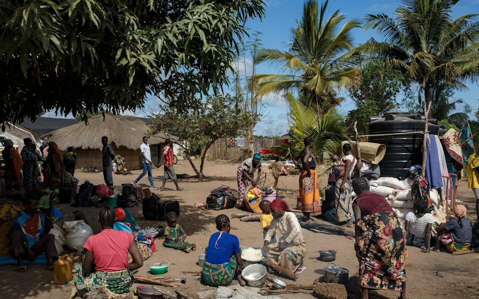 People displaced by conflict wait at a full resettlement area near Montepuez, Cabo Delgado. - Ed Ram
