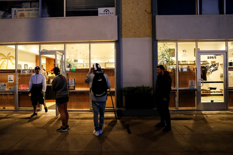 FILE PHOTO: People stand in line outside the Barbary Coast Sunset Cannabis Dispensary prior to the citywide shelter in place order amid the novel coronavirus (COVID-19) outbreak in San Francisco