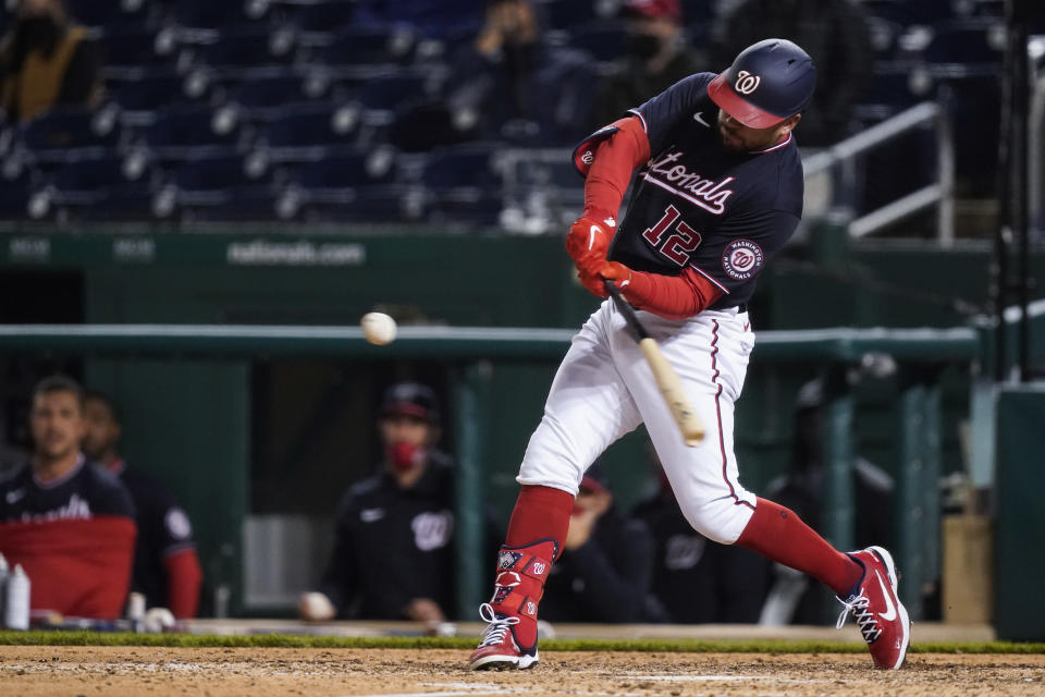 Washington Nationals' Kyle Schwarber hits a home run during the ninth inning of the team's baseball game against the Arizona Diamondbacks at Nationals Park, Friday, April 16, 2021, in Washington. The Nationals won 1-0. (AP Photo/Alex Brandon)