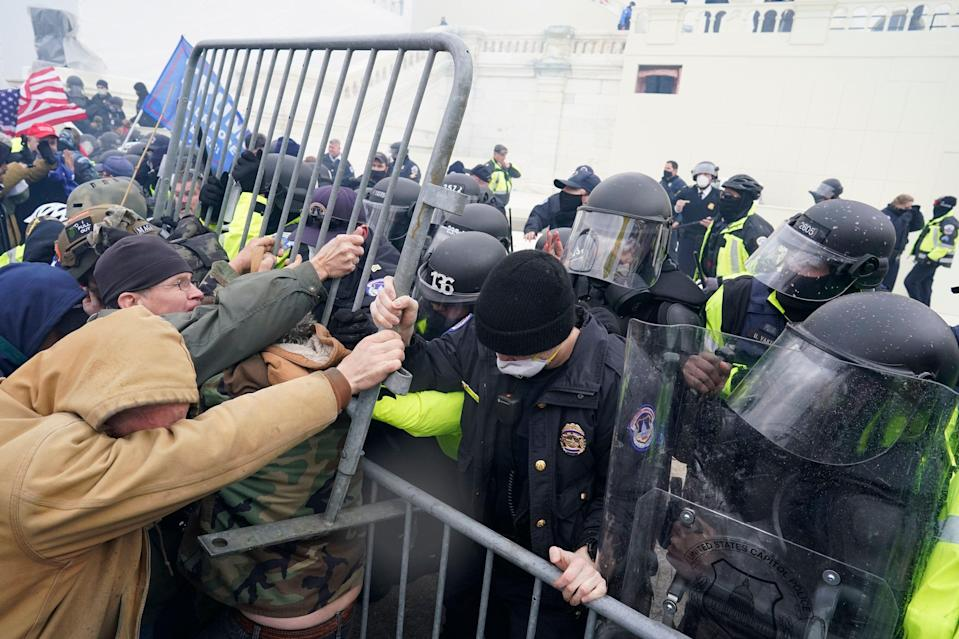 Police tried to hold back the pro-Trump mob attempting to get into the Capitol on Jan. 6. (Kent Nishimura/Getty Images)