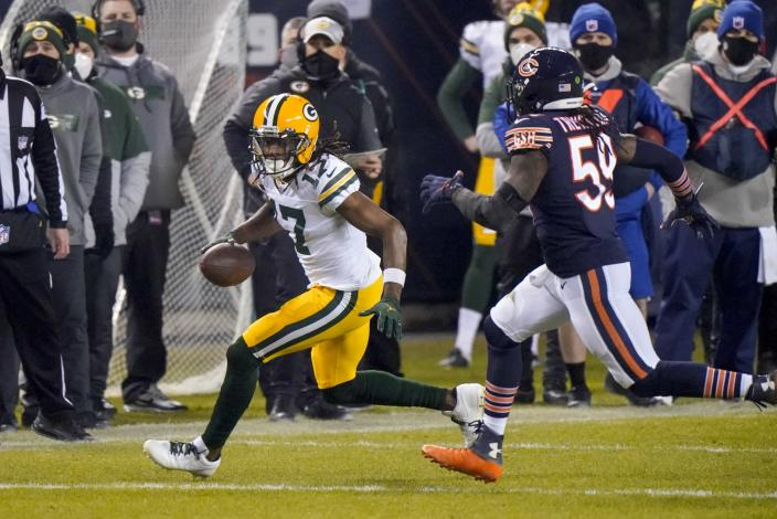 Green Bay Packers' Davante Adams catches a pass with Chicago Bears' Danny Trevathan defending during the second half of an NFL football game Sunday, Jan. 3, 2021, in Chicago. (AP Photo/Nam Y. Huh)