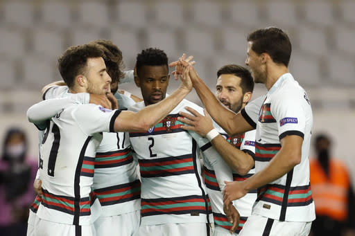 Portugal players celebrate after scoring their second goal during the UEFA Nations League soccer match between Croatia and Portugal at the Poljud stadium in Split, Croatia, Tuesday, Nov. 17, 2020. (AP Photo/Darko Bandic)