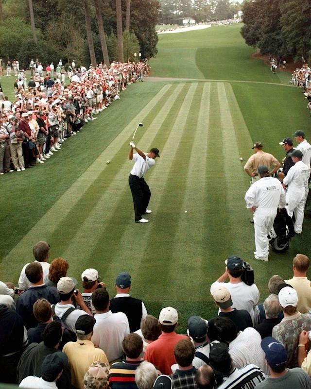<p>Surrounded by the gallery, defending Masters champion Tiger Woods drives off of the 18th tee during the final day of practice for the 1998 Masters at the Augusta National Golf Club in Augusta, Ga., Wednesday, April 8, 1998. (AP Photo/Dave Martin) </p>