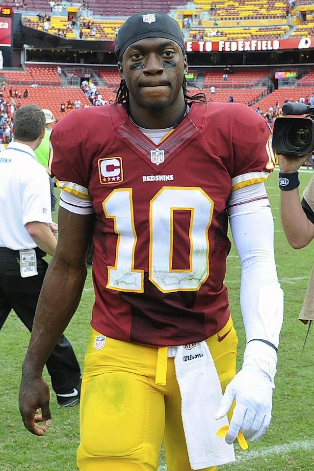 Washington Redskins quarterback Robert Griffin III walks off the field after an NFL football game against the Detroit Lions in Landover, Md., Sunday, Sept. 22, 2013. The Lions 27-20, breaking a 21-game losing streak to the Redskins at the Redskins home stadium. (AP Photo/Richard Lipski)