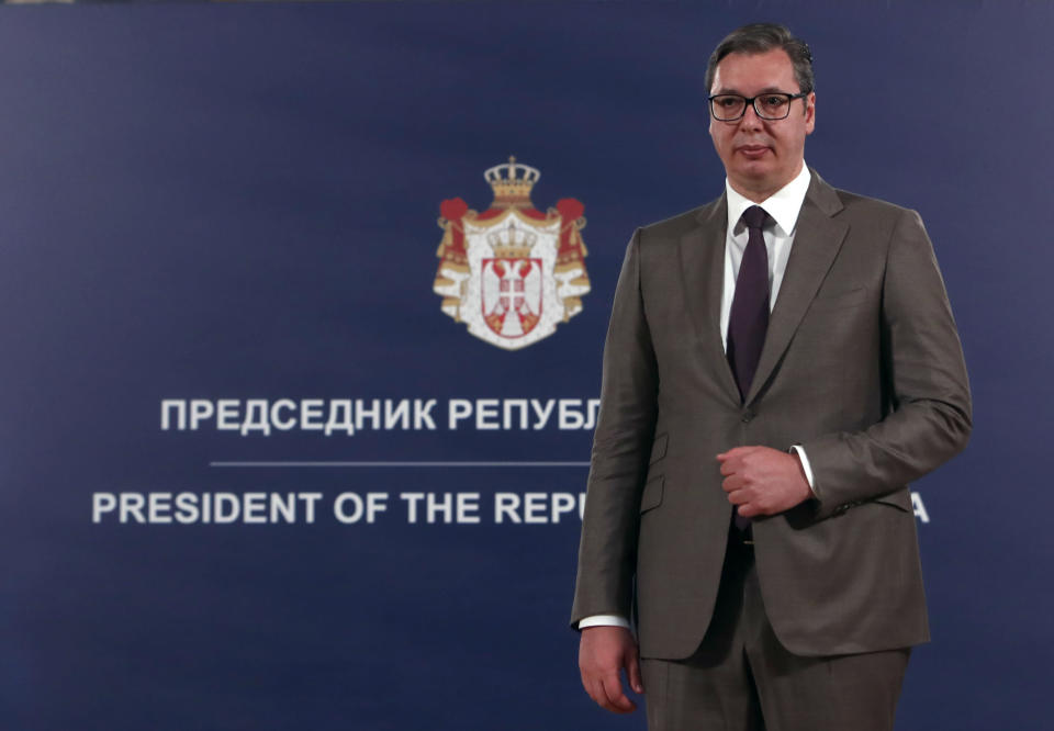 Serbian President Aleksandar Vucic stands during a ceremony in Belgrade, Serbia, Sunday, May 9, 2021. Serbia has decorated Austrian Nobel literature laureate Peter Handke, who is known for his apologist views over Serb war crimes during the 1990s' wars in the Balkans. (AP Photo/Darko Vojinovic)