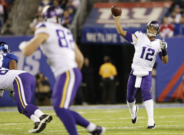 Minnesota Vikings quarterback Josh Freeman (12) throws a pass during the first half of an NFL football game against the New York Giants Monday, Oct. 21, 2013 in East Rutherford, N.J. (AP Photo/Julio Cortez)