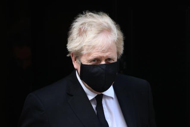 Prime Minister Boris Johnson emerging from Downing Street with a haircut after the easing of restrictions (Aaron Chown/PA)