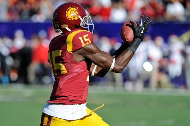 Southern California wide receiver Nelson Agholor (15) makes a touchdown reception against Fresno State in the first quarter of the Royal Purple Bowl NCAA college football game, Saturday, Dec. 21, 2013 in Las Vegas. (AP Photo/David Cleveland)