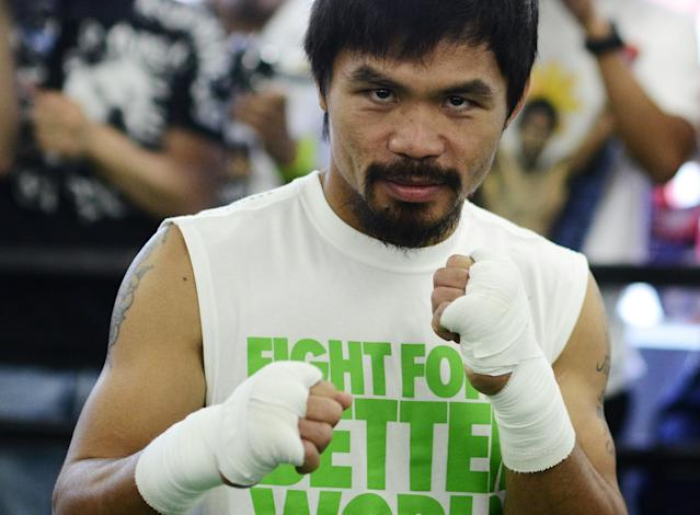 Philippines boxer Manny Pacquiao strikes a pose during a media workout at Wild Card Boxing Club on May 30, 2012 in Hollywood, California.The workout is in advance of Pacquiao's upcoming WBO welterweight championship fight against Timothy Bradley of US on June 9 at the MGM Grand in Las Vegas. AFP PHOTO/JOE KLAMARJOE KLAMAR/AFP/GettyImages
