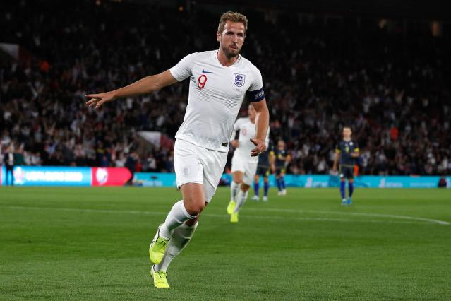 Harry Kane celebrates putting England in front. (ADRIAN DENNIS/AFP/Getty Images)