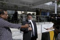 Faisal Siddiqi, a lawyer for the family of Daniel Pearl, an American reporter who was kidnapped and killed in Pakistan, talks to media outside the Supreme Court after an appeal hearing in the case in Islamabad, in Islamabad, Pakistan, Wednesday, Oct. 7, 2020. Ahmed Omar Saeed Sheikh, who has been on death row over the 2002 killing of U.S. journalist Daniel Pearl, will remain in jail for another three months under a government order, a prosecutor told the country's top court Wednesday, as it took up appeals of Pearl's family and government against acquittal of all accused of murder charges by another court. (AP Photo/Anjum Naveed)