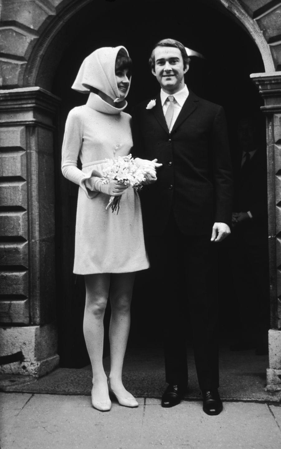 <p>The popular '60s trend of brides wearing short wedding dresses was still going strong at the end of the decade, and some brides opted for a hat as opposed to a veil. Audrey Hepburn went for both trends, wearing a short dress <em>and</em> a head-covering.</p>