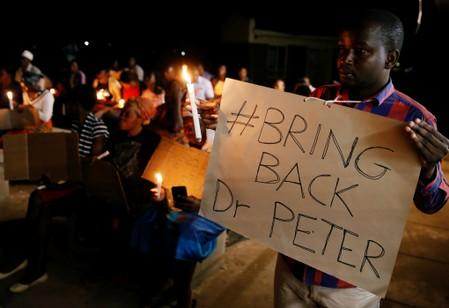 Zimbabwean healthcare workers hold a candlelight vigil to protest over the disappearance of Peter Magombeyi, the leader of their union in Harare