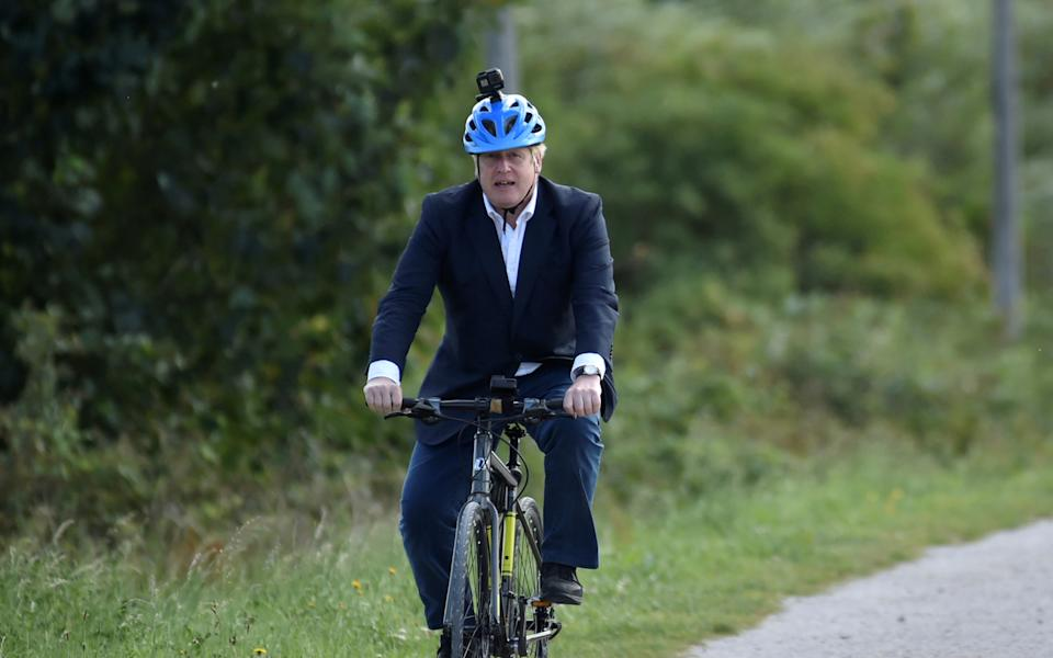 Boris Johnson pictured riding a bike in July last year. His bike ride around London's Olympic Park on Sunday continues to be a talking point. (Rui Vieira/pool via Reuters)