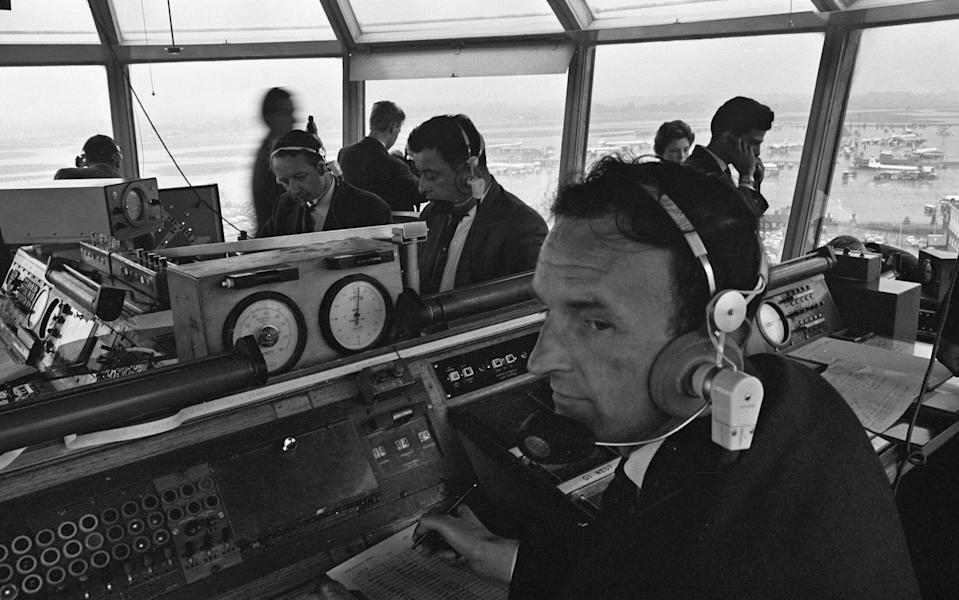 Air traffic controllers in the control tower at Heathrow Airport handling departing and arriving flights, 18th October 1964. (Photo by Randle/Mirrorpix/Getty Images)  - Getty