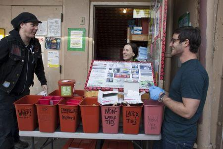 (L-R) Shilo Murphy, Misty Kohal, and Jeff Sablosky prepare to open the People's Harm Reduction Alliance, the nation's largest needle-exchange program, in Seattle, Washington April 30, 2015. REUTERS/David Ryder