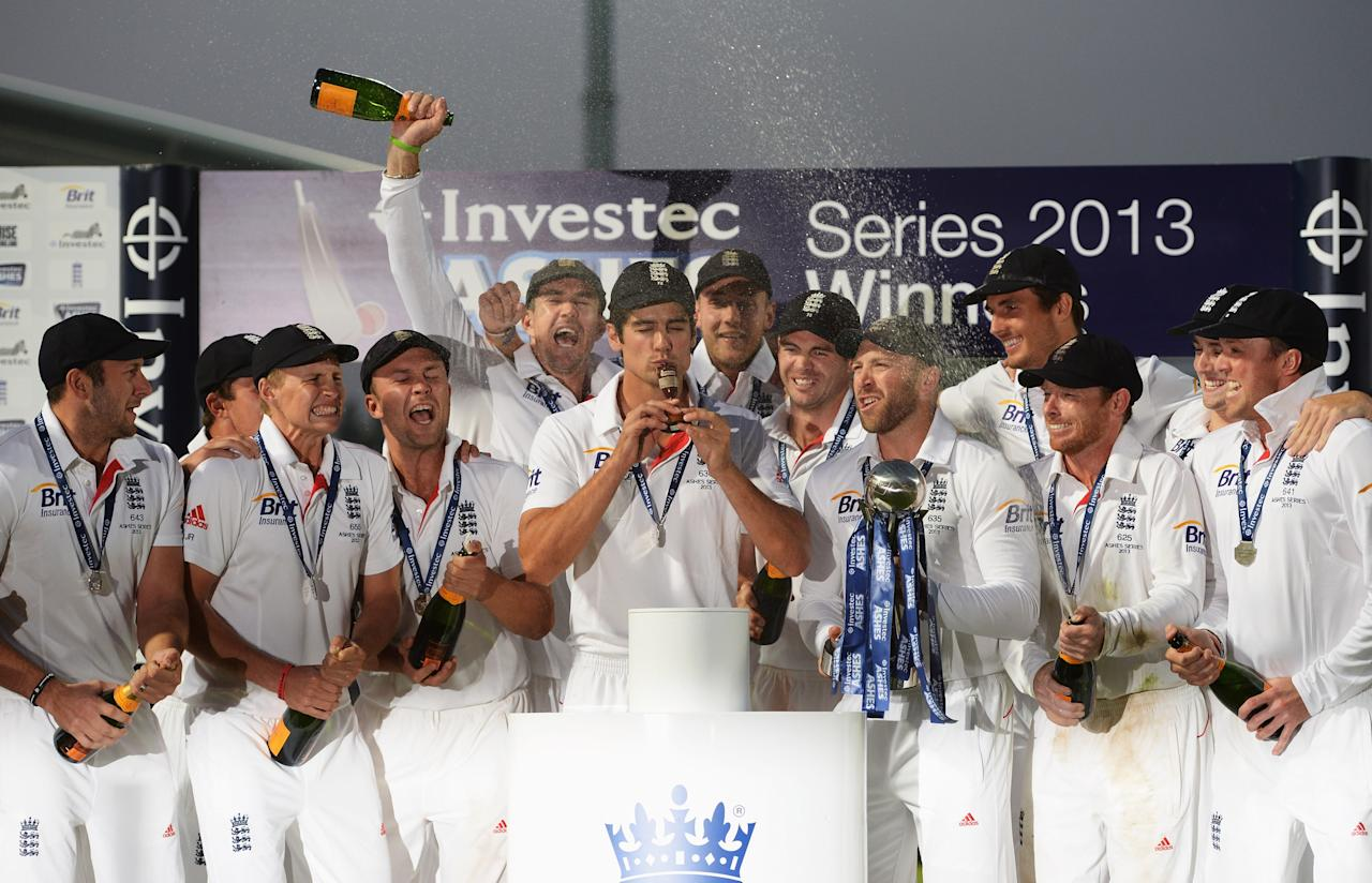 LONDON, ENGLAND - AUGUST 25: Alastair Cook of England kisses the urn after winning the Ashes during day five of the 5th Investec Ashes Test match between England and Australia at the Kia Oval on August 25, 2013 in London, England. (Photo by Gareth Copley/Getty Images)