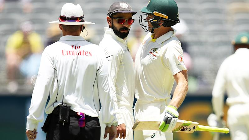 Virat Kohli and Tim Paine, pictured here in a bizarre clash during the second Test in 2018.