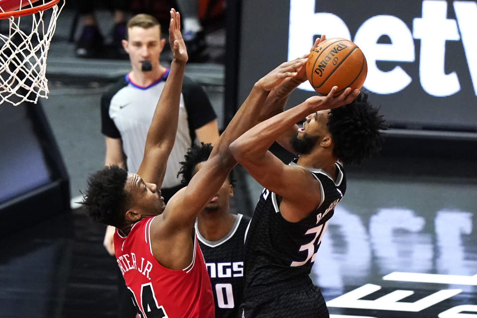 Sacramento Kings forward Marvin Bagley III, right, shoots against Chicago Bulls center Wendell Carter Jr., during the first half of an NBA basketball game in Chicago, Saturday, Feb. 20, 2021. (AP Photo/Nam Y. Huh)