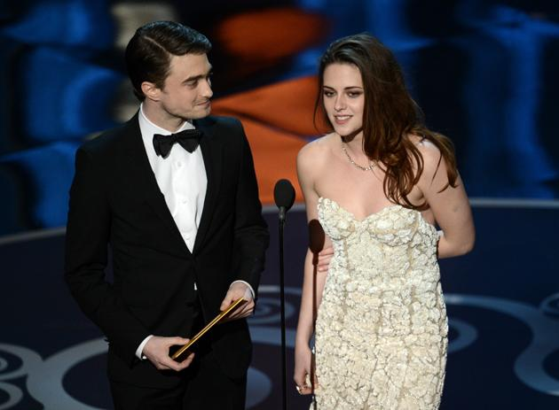HOLLYWOOD, CA - FEBRUARY 24: Actor Daniel Radcliffe and actress Kristen Stewart present onstage during the Oscars held at the Dolby Theatre on February 24, 2013 in Hollywood, California. (Photo by Kevin Winter/Getty Images)