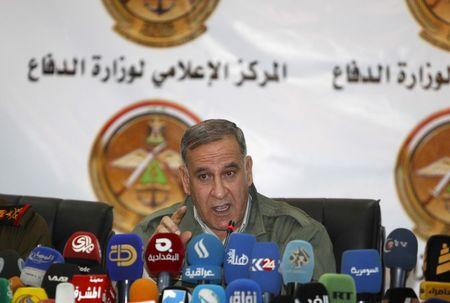 Iraq's Defence Minister Khaled al-Obeidi speaks during a news conference in Baghdad