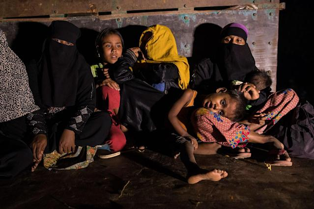 <p>Rohingya women and children sit in a truck waiting to be transported from the border area to various camps on October 13, 2017, in Teknaf, Cox's Bazar, Bangladesh. (Photograph by Paula Bronstein/Getty Images) </p>