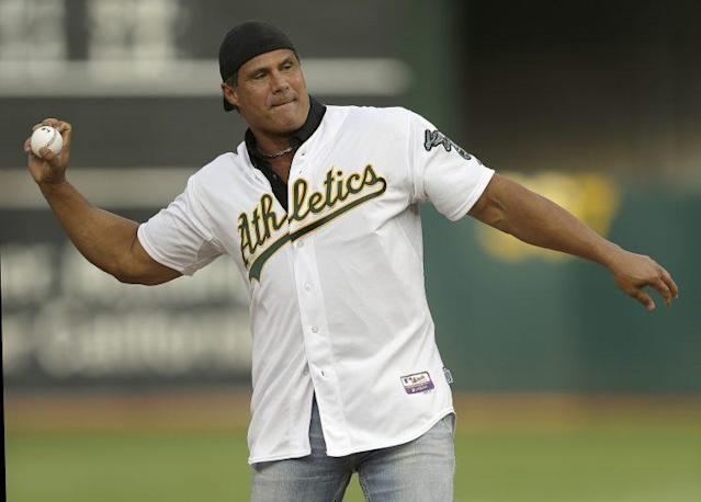 Jose Canseco will suit to play baseball once again. (AP Photo)