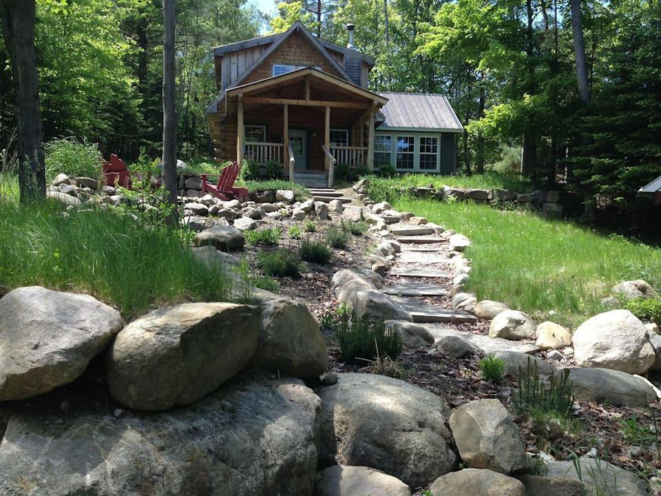 """<h2>Indian Lake Cabin</h2><br><strong>Location:</strong> Indian Lake, New York<br><strong>Sleeps:</strong> 6<br><strong>Price Per Night:</strong> $200<br><em>Check availability <strong><a href=""""http://airbnb.pvxt.net/GMMY6"""" rel=""""nofollow noopener"""" target=""""_blank"""" data-ylk=""""slk:here"""" class=""""link rapid-noclick-resp"""">here</a></strong></em><br><br>""""Beautiful cabin situated in the heart of the Adirondacks. Access to Indian Lake with kayaks available for your use. Breathtaking fall foliage. Multiple hiking trails nearby, close to Adirondack Museum. All of our guests have visited again! Sleeps four adults, or two adults and up to four children.""""<br><br>"""