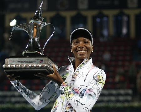 Williams of the U.S. holds the trophy after defeating Cornet of France in their women's singles final match at the Dubai Tennis Championships