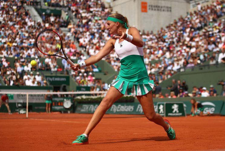 Kristina Mladenovic reaches for a backhand shot against Gabine Muguruza in the fourth round of the French Open (Getty Images).