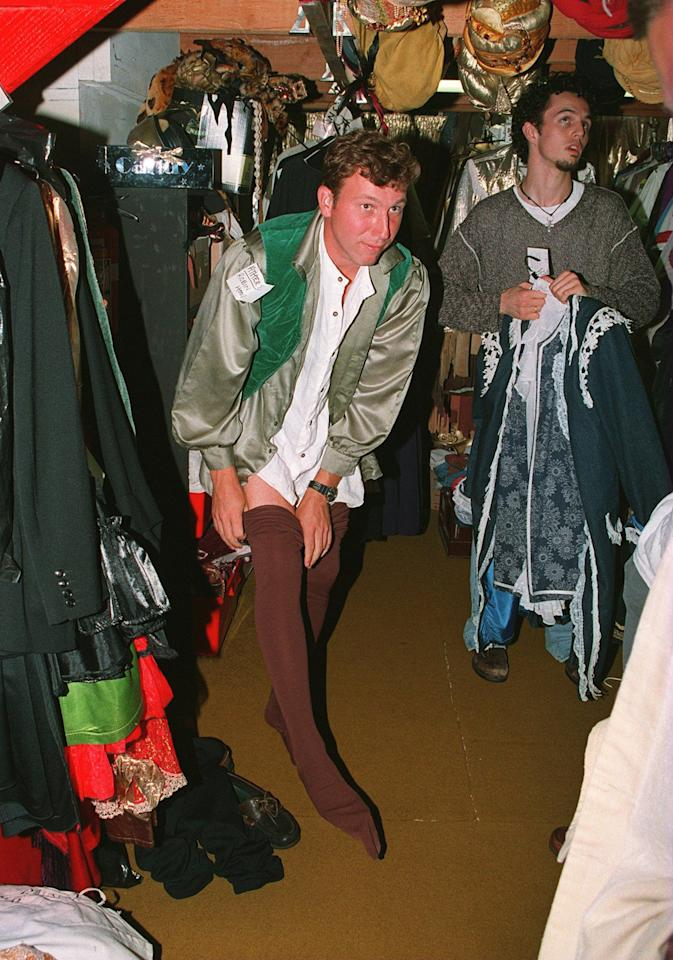 21 DEC 1994: ENGLAND CRICKETERS  TRY THEIR FANCY DRESS OUTFITS ON FOR THE CHRISTMAS DINNER  MIKE ATHERTON PULLS ON HIS TIGHTS AS ROBIN HOOD  Mandatory Credit: Ben Radford/ALLSPORT