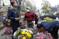 """Flower sellers arrange their flowers ahead of the Persian New Year, or Nowruz, meaning """"New Day."""" in northern Tajrish Square, Tehran, Iran, Monday, March 15, 2021. (AP Photo/Vahid Salemi)"""