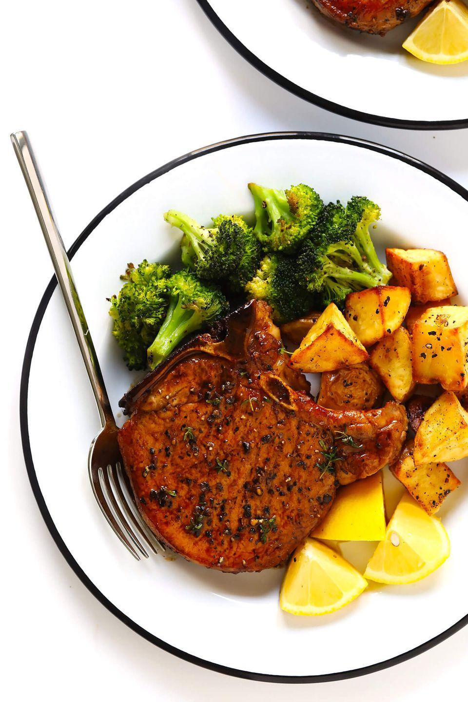 """<p>These juicy pork chops are simply seasoned but oh so delicious.</p><p><strong>Get the recipe at <a href=""""https://www.gimmesomeoven.com/baked-pork-chops/"""" rel=""""nofollow noopener"""" target=""""_blank"""" data-ylk=""""slk:Gimme Some Oven"""" class=""""link rapid-noclick-resp"""">Gimme Some Oven</a>.</strong></p>"""