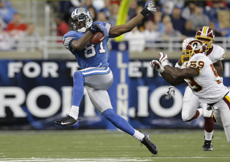 FILE - In this Oct. 26, 2008, file photo, Detroit Lions wide receiver Calvin Johnson makes catch against the Washington Redskins in the fourth quarter of an NFL football game in Detroit. Calvin Johnson is simply in awe that he will soon join Jim Brown and Gale Sayers as Pro Football Hall of Famers inducted at the age of 35 years old or younger. (AP Photo/Paul Sancya, File)