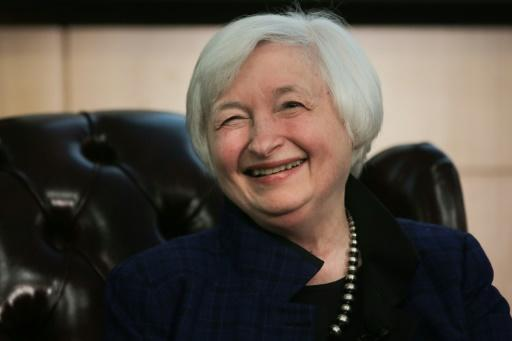 US stocks up, dollar down as Yellen signals likely rate hike