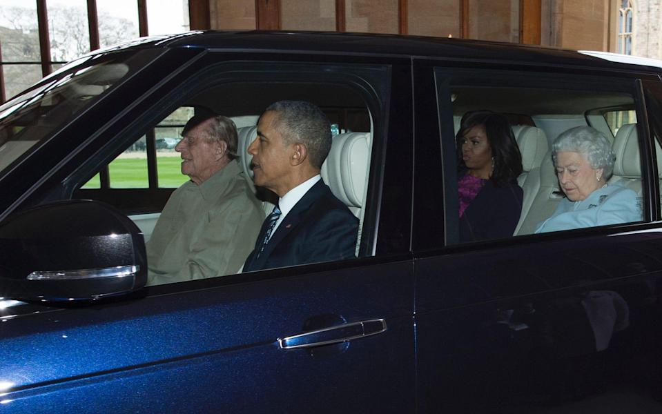 The late Duke of Edinburgh driving former US president Barack Obama and former US first lady Michelle Obama in 2016 - GEOFF PUGH/AFP