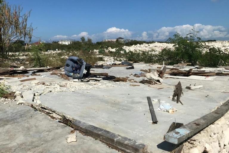 Belongings litter the site of a destroyed shanty in Turks and Caicos, in January 2019