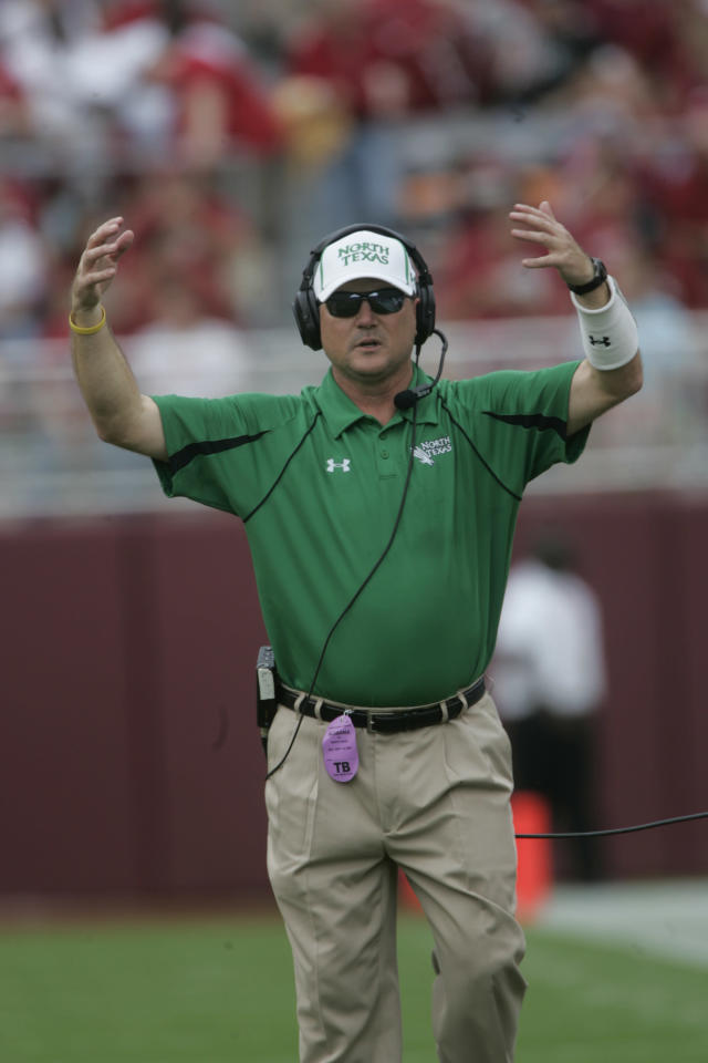 "<p>2007 — ""Check With Me"" pre-snap adjustments at the line of scrimmage, signaled in from the sidelines, start to proliferate. Among the early practitioners: Todd Dodge as head coach at North Texas and Tony Franklin as offensive coordinator at Troy. (Photo credit: AP) </p>"