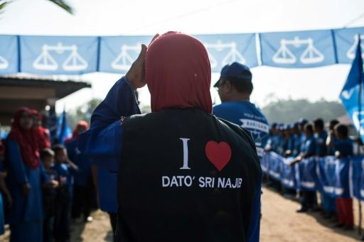 A supporter waits for the arrival of the Malaysian Prime Minister Najib Razak of the ruling coalition party Barisan Nasional during a campaign event ahead of the upcoming 14th general elections