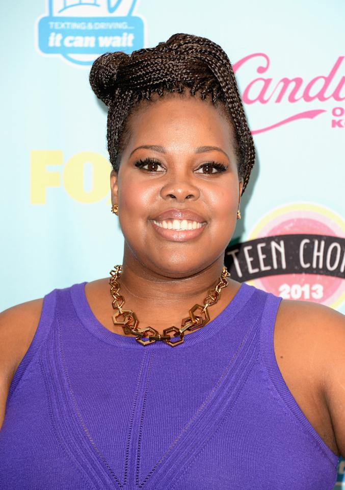 """UNIVERSAL CITY, CA - AUGUST 11: Actress Amber Riley, winner of Choice TV Show: Comedy for """"Glee,"""" attends the Teen Choice Awards 2013 at Gibson Amphitheatre on August 11, 2013 in Universal City, California. (Photo by Jason Merritt/Getty Images)"""