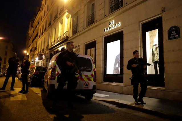 <p>Policemen stand guard in Paris centre after one person was killed and several injured in a knife attack in Paris on May 12, 2018. (Photo: Thomas Samson/AFP/Getty Images) </p>