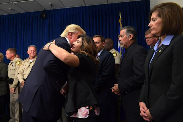 President Donald Trump salutes first responders as he visits the Metropolitan Police Department command center in Las Vegas on Oct. 4, 2017. (MANDEL NGAN via Getty Images)