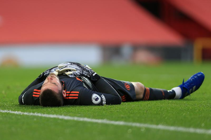 MANCHESTER, ENGLAND - OCTOBER 04: Man Utd goalkeeper David de Gea lies on the floor exhausted during the Premier League match between Manchester United and Tottenham Hotspur at Old Trafford on October 4, 2020 in Manchester, United Kingdom. Sporting stadiums around the UK remain under strict restrictions due to the Coronavirus Pandemic as Government social distancing laws prohibit fans inside venues resulting in games being played behind closed doors. (Photo by Simon Stacpoole/Offside/Offside via Getty Images)