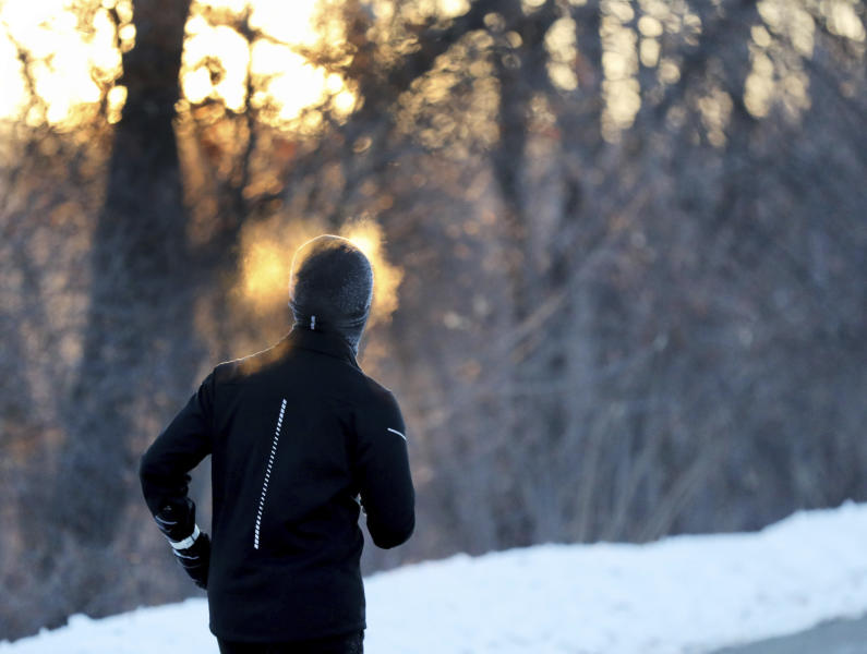 A runner endures the cold while running along West River Parkway, Thursday, Feb. 13, 2020, near downtown Minneapolis, as temperatures hover near minus 30 degrees Fahrenheit with wind chills. (David Joles/Star Tribune via AP)