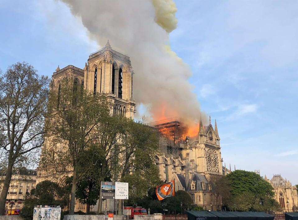 <p>Notre Dame cathedral is burning in Paris, Monday, April 15, 2019. Massive plumes of yellow brown smoke is filling the air above Notre Dame Cathedral and ash is falling on tourists and others around the island that marks the center of Paris. (AP Photo) </p>