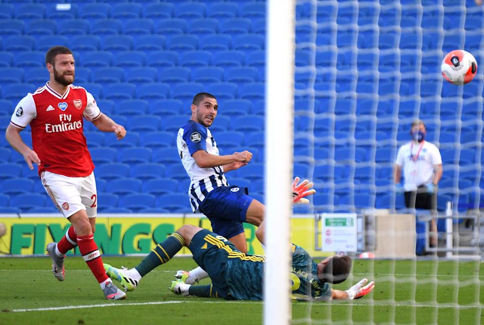 BRIGHTON, ENGLAND - JUNE 20: Neal Maupay of Brighton and Hove Albion scores his team's second goal past Emiliano Martinez of Arsenal during the Premier League match between Brighton & Hove Albion and Arsenal FC at American Express Community Stadium on June 20, 2020 in Brighton, England. Football Stadiums around Europe remain empty due to the Coronavirus Pandemic as Government social distancing laws prohibit fans inside venues resulting in all fixtures being played behind closed doors. (Photo by Mike Hewitt/Getty Images)